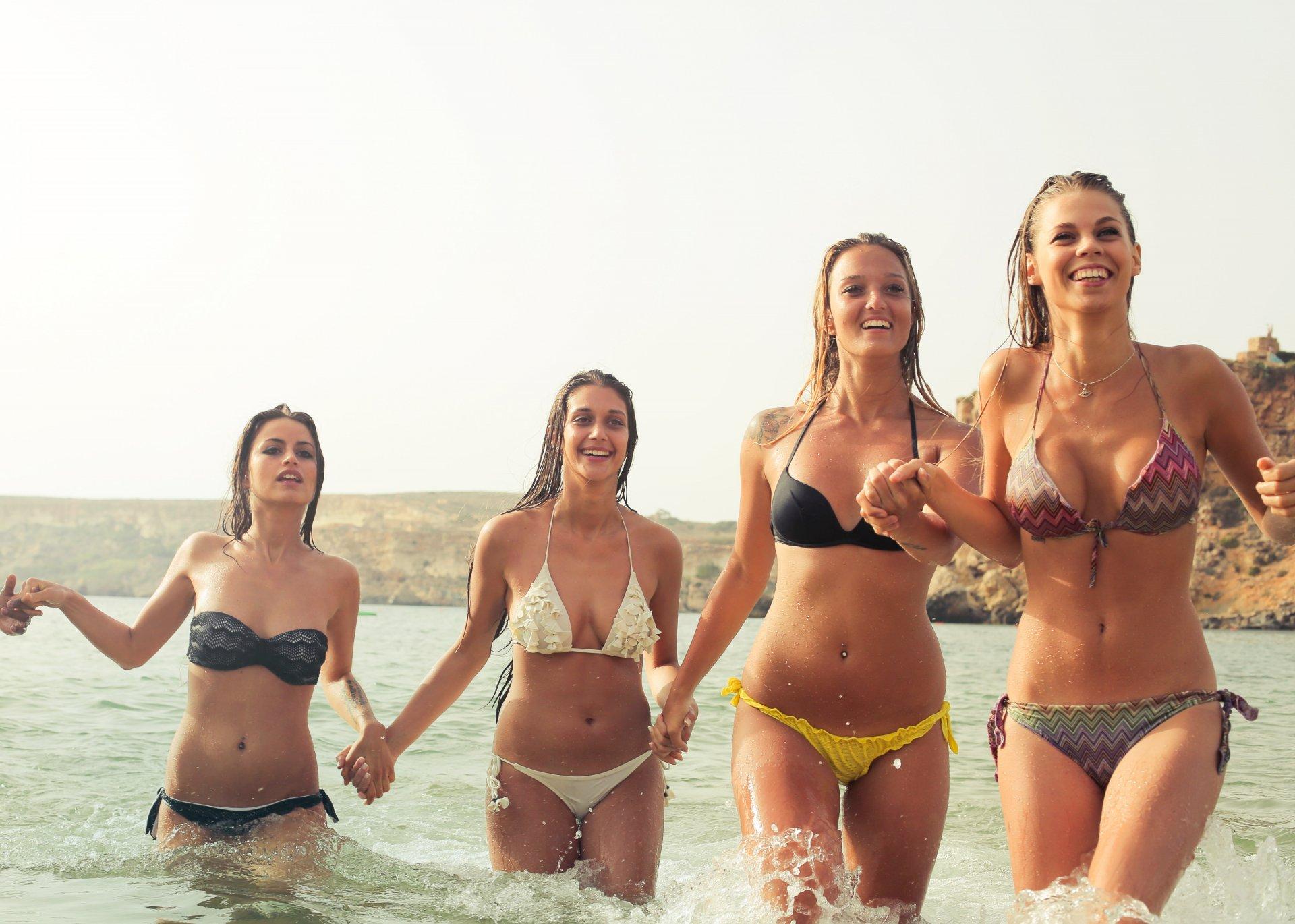 group-of-woman-wearing-bikini-on-body-of-water-815996.jpg