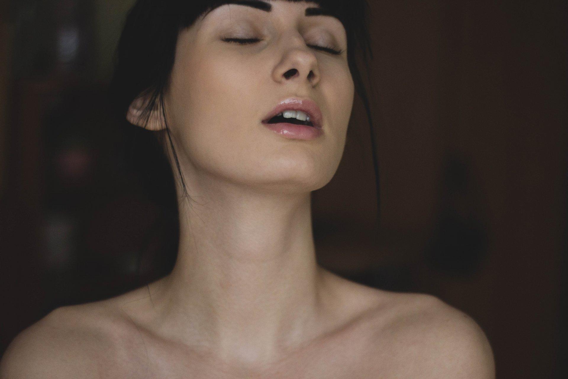 topless-woman-closing-her-eyes-185481.jpg
